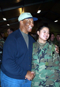 """Mr. Cub®"" Ernie Banks poses Dec. 19, 2000, with an Army sergeant at Task Force Eagle headquarters in Tuzla, Bosnia."